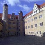 Schloss Lichtenburg: Streit verhindert Tor-Sanierung